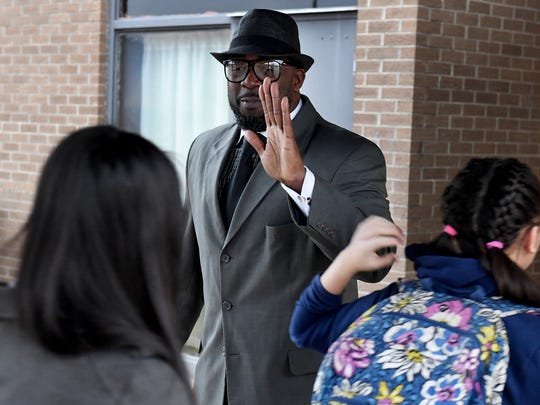 Pastor Undrae Johnson gives Haywood County High School students high fives as they walk into school, Wednesday morning. Johnson was joined with other parents and adults to show their support for the students after the student-lead protests, Monday and Tuesday.
