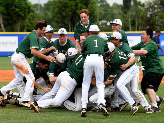 The Greene Devils of Greeneville High School celebrate in a dog pile after defeating Riverside High School, 11-0, in five innings to become the 2018 TSSAA Class AA State Baseball Tournament, Friday, May 25.