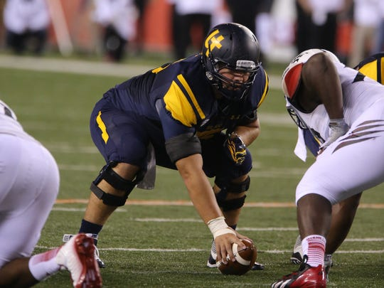 University of Toledo offensive lineman Greg Mancz, a graduate of Anderson Township, prepares for a play against the University of Cincinnati in a 58-34 loss to the Bearcats Sept. 12, 2014.