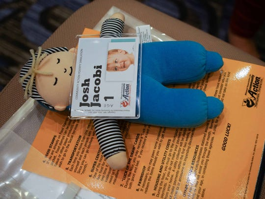 A baby doll symbolizing a real low-income child living in poverty was used during the simulation training for Red Clay educators from Warner Elementary, Highlands Elementary, and Shortlidge Academy.