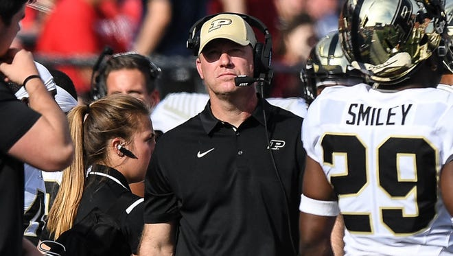 Purdue Boilermakers head coach Jeff Brohm walks the sidelines in the game against Rutgers Scarlet Knights at High Point Solutions Stadium.