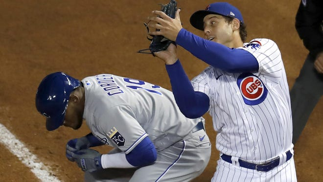 Chicago Cubs first baseman Anthony Rizzo, right, catches a popup. Rizzo won his fourth Gold Glove award days after the Cubs picked up their $16.5 million option to bring him back for another season.