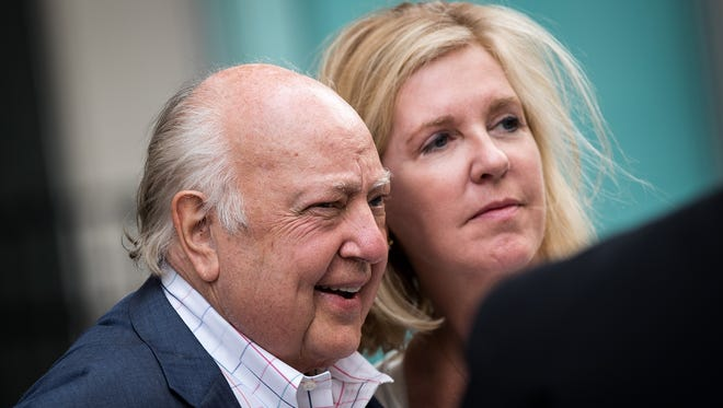 Fox News chairman Roger Ailes walks with his wife Elizabeth Tilson as they leave the News Corp building on July 19, 2016, in New York.