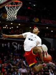 Joshua Reaves of Oak Hill Academy throws down a dunk