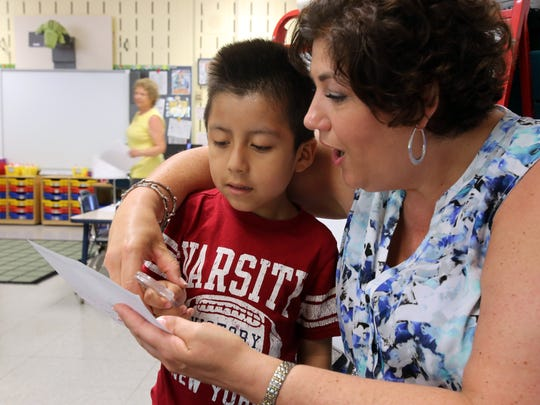 Kindergartner Christopher Loja locates a consonant