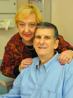 Regis Magyar, seen here with his wife, Pat, has been revived on  three occasions by the LifeVest,a lightweight wearable defibrillator.