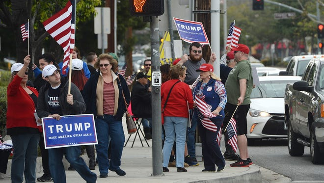 Supporters for President Donald Trump hold a rally at Cochran Street and Sycamore Drive in Simi Valley on Saturday afternoon.