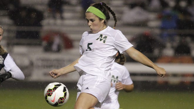 Sophie Gorman of McNicholas runs through the ball to gain possession against a tough Granville team in the state semifnal match in 2014.