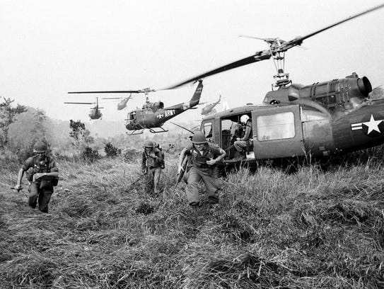 American soldiers are dropped off by U.S.Army helicopters