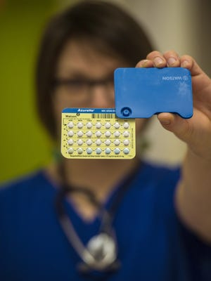 A health care associate at Planned Parenthood of Northern New England in Burlington holds a packet of oral contraceptives on Tuesday, March 15, 2016..