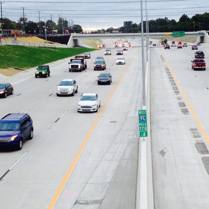 Traffic flows on the newly reopened I-96 on Monday morning September 22, 2014. Regina H. Boone