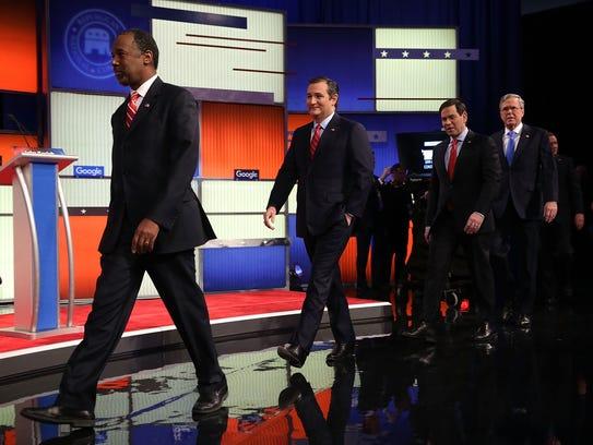 Republican presidential candidates (R-L) Jeb Bush,