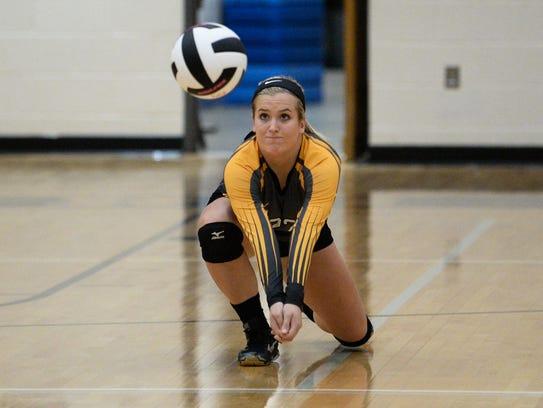 Crescent senior Ryleigh Davis (22) saves a ball against