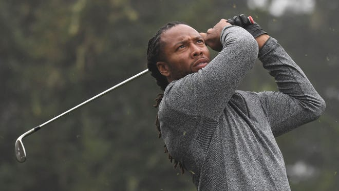 Larry Fitzgerald hits his tee shot on the 12th hole during the second round of the AT&T Pebble Beach Pro-Am at Spyglass Hill Golf Course.