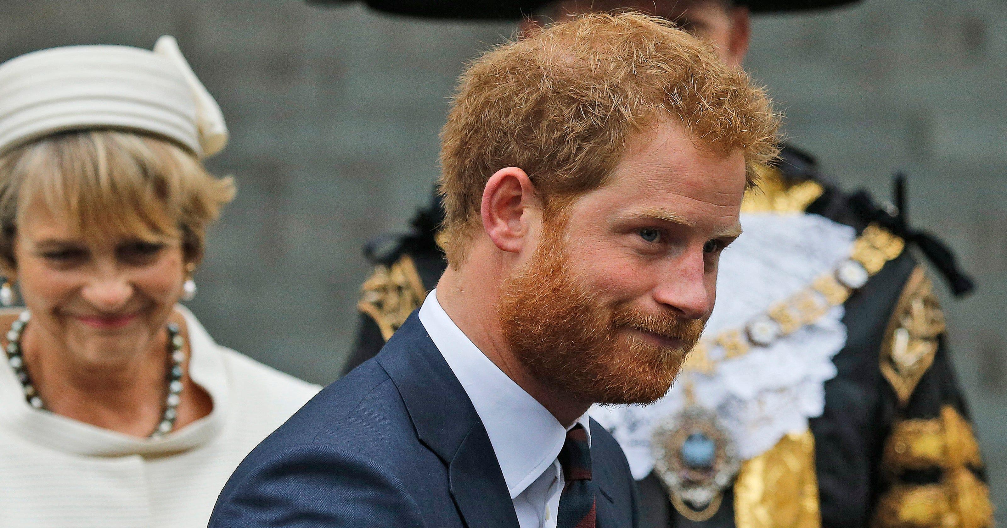 Still-hairy Prince Harry hails war veterans