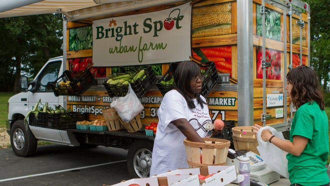 The Nemours-led effort will seek to expand things like farmer's markets, like the Bright Spot Urban Farm's operation shown here, to help Wilmington residents improve diets and health.