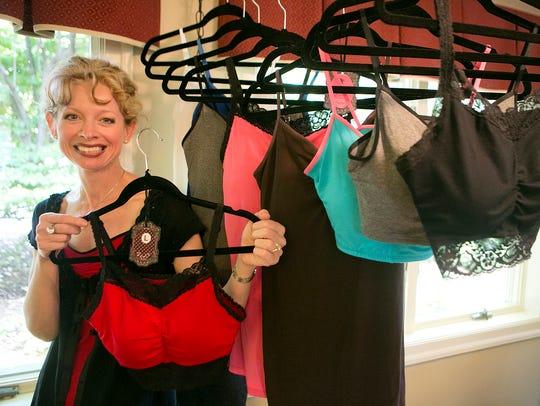 Gurlz Brand Lingerie owner Rita Weiler holds up a bra