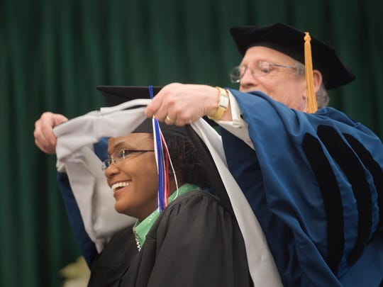 C. Kim Bracey receives her honorary degree during the York College graduation.