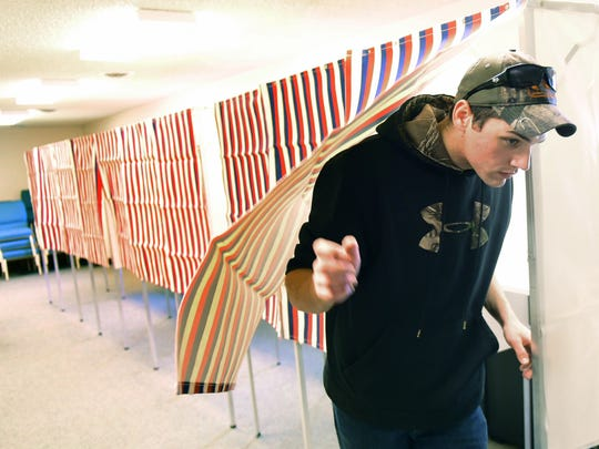 Devenn Carter, a Franklin County employee, leaves a voting booth he helped to set up Monday, April 25, 2016 at Cornerstone Church of Christ, Hamilton Township. Tuesday is primary election day in Pennsylvania.
