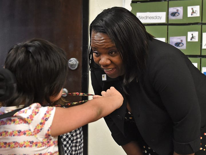 WCSD superintendent Traci Davis interacts with a student