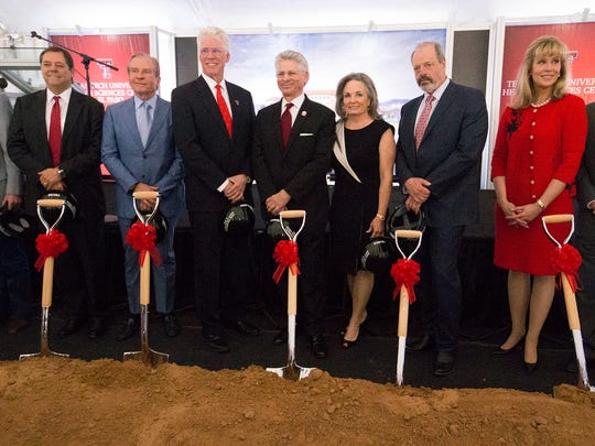 Dr. Richard Lange, third from left, president of Texas Tech University Health Sciences Center El Paso and Rick Francis, to his right, Texas Tech University System board of regents chairman, pose with business leaders and others after symbolically breaking ground Tuesday on an $83 million Medical Sciences Building across Concepcion Street from the Paul L. Foster School of Medicine. Also pictured are businessmen Paul L. Foster, far left, Woody L. Hunt, second from left, and El Paso Mayor Oscar Leeser, second from right.