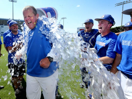 CAK's Tommy Pharr is doused with the water bucket following