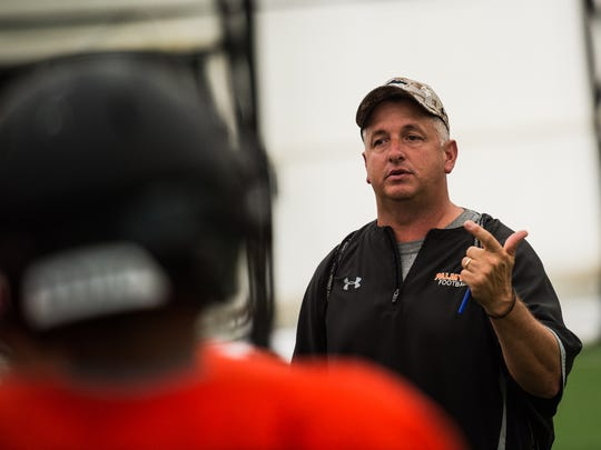 Palmyra head coach Chris Pope talks to his team at a recent practice. The Cougars went 8-2 in 2016 and are looking to continue that success this season.