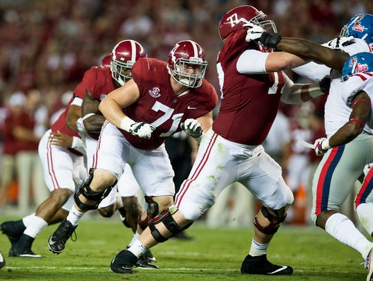 Alabama offensive linemen Ross Pierschbacher (71) and