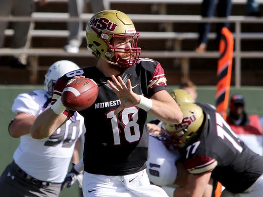 Midwestern State's Layton Rabb throws on the run against Sioux Falls Saturday, Nov. 18, 2017, at Memorial Stadium. The Mustangs defeated the Cougars 24-20 in the first round of the NCAA DII Playoffs.