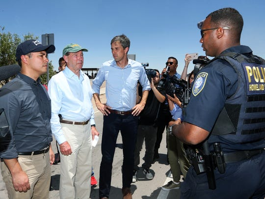 Three members of Congress are met by a U.S. Customs and Border Protection official at the entrance to the Marcelino Serna Port of Entry to visit undocumented immigrant children housed there Saturday. They are from left: Joaquin Castro, D-San Antonio, Tom Udall, D-NM and Beto O'Rourke, D-El Paso. They were later joined by six more members of Congress who entered the facility.
