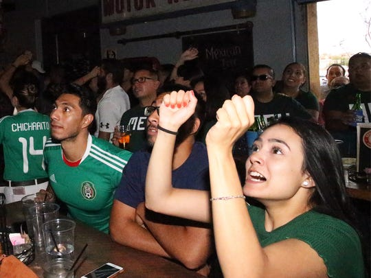 Mexico fan Sadie Salgado watches in anticipation as her team advances to the goal against Brazil Monday.