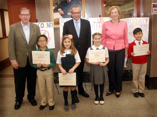 "Union County Sheriff Joseph Cryan, Union County Clerk Joanne Rajoppi and Union County Surrogate James LaCorte congratulated the top winners of the 2016 ""My County"" poster contest sponsored by the Union County Constitutional Officers.  The top winners of the contest are (from second left): Reed Cabral (first place) from St. Bartholomew Academy in Scotch Plains, Tatiana Fecowycz (second place) from Holy Trinity Interparochial School in Westfield, Julia Polo (third place) from St. John the Apostle Elementary School in Clark, and Jonathan Moncayo (fourth place) from the Ronald Reagan Academy #30 in Elizabeth."