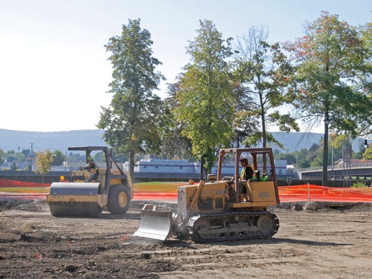 Work continues Wednesday to level fill at the demolition site where the former Rosenbaum's and Marvin's buildings once stood on West Water Street in Elmira.