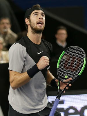 Karen Khachanov of Russia reacts after winning a point against Lucas Pouille of France during their final match at the Open 13.