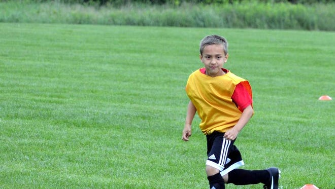 Caleb playing soccer