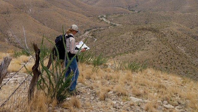 A hiker explores Chatfield Canyon in Otero County. Heightened wildfire risk has led BLM to restrict campfires, fireworks, and smoking on public lands in six southern New Mexico counties.