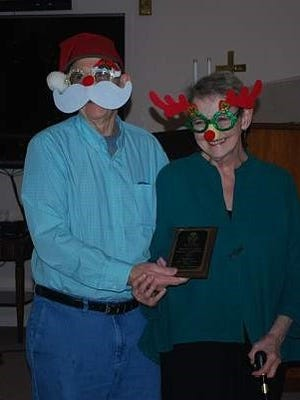 Mike and Judy Kuenzli, dressed as Santa Claus and Rudolph the Reindeer, were recently presented with the award for Baxter County Project of the Year at the Master Gardeners' annual holiday luncheon. The two are the project leaders for the Fairgrounds garden in front of the Education Building at the Baxter County Fairgrounds.