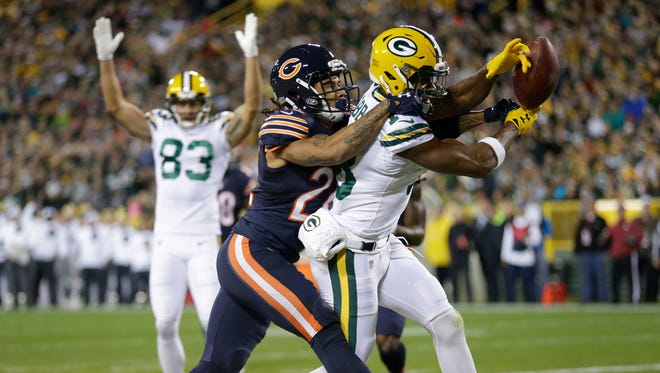 Green Bay Packers wide receiver Randall Cobb can't hold on to a touchdown pass while defended by Chicago Bears cornerback Cre'von LeBlanc.
