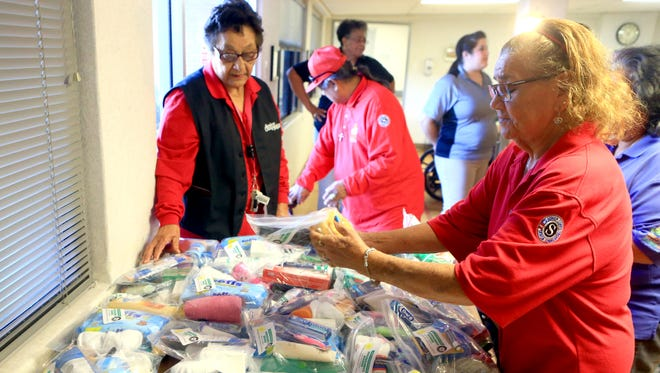 Volunteer Christine Head (right), from Senior Companion Program, prepares packages with toiletries for residents from San Rafael Nursing and Rehabilitation Center on Tuesday, Jan. 24, 2017, in Corpus Christi.
