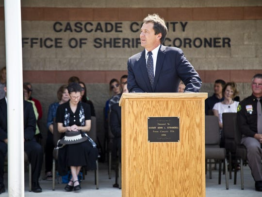 Gov. Steve Bullock speaks during the Joseph Dunn highway dedication ceremony Wednesday at the Cascade County Sheriff''s Office. Bullock faced away from the crowd during his speech to make condolences to Dunn's family.