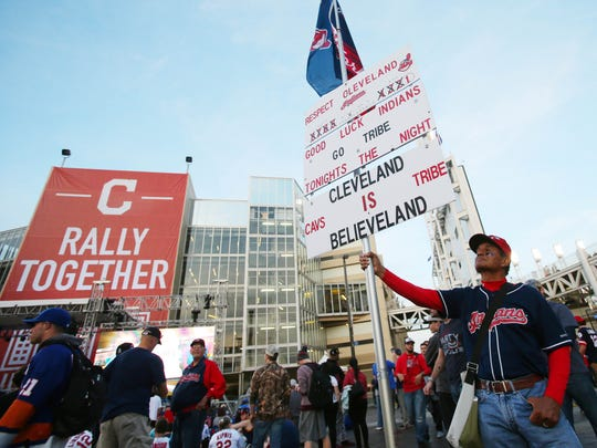 Cleveland Indians fan John Rivera holds up a sign before game seven of the 2016 World Series against the Chicago Cubs at Progressive Field. Mandatory Credit: Jerry Lai-USA TODAY Sports