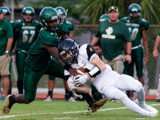 Brock Gee (1) of Bishop Verot catches the ball against