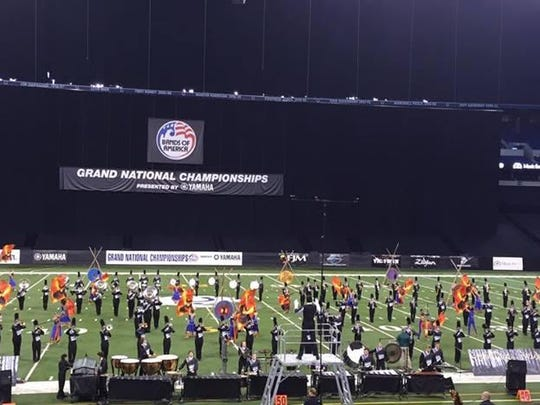 The Ryle High School Marching Band performs inside