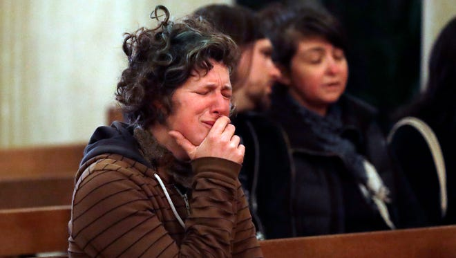 Genevieve Griseau cries as she attends a memorial for victims of a warehouse fire at Chapel of the Chimes Saturday, Dec. 3, 2016, in Oakland, Calif.