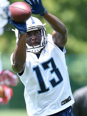 Titans wide receiver Taywan Taylor pulls in a catch during OTA practice May 25, 2017.