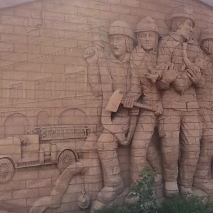 "A Tribute to Firefighters: Jay Tschetter's carved brick ""A Tribute to Firefighters"" was inspired by the Oklahoma City federal building tragedy and features images of Glendale's first fire station and fire truck."