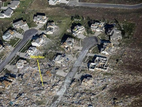 Cori Faklaris' brother-in-law identified this area in a Chicago Tribune photograph as the remains of the house shared by her parents and brother in Washington, Illinois, before it was destroyed by a tornado Sunday.