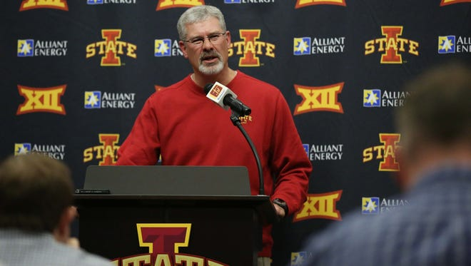 Iowa State coach Paul Rhoads holds a news conference on Monday, the day after he was fired from the program. Rhoads will coach one final game with the Cyclones on Saturday.