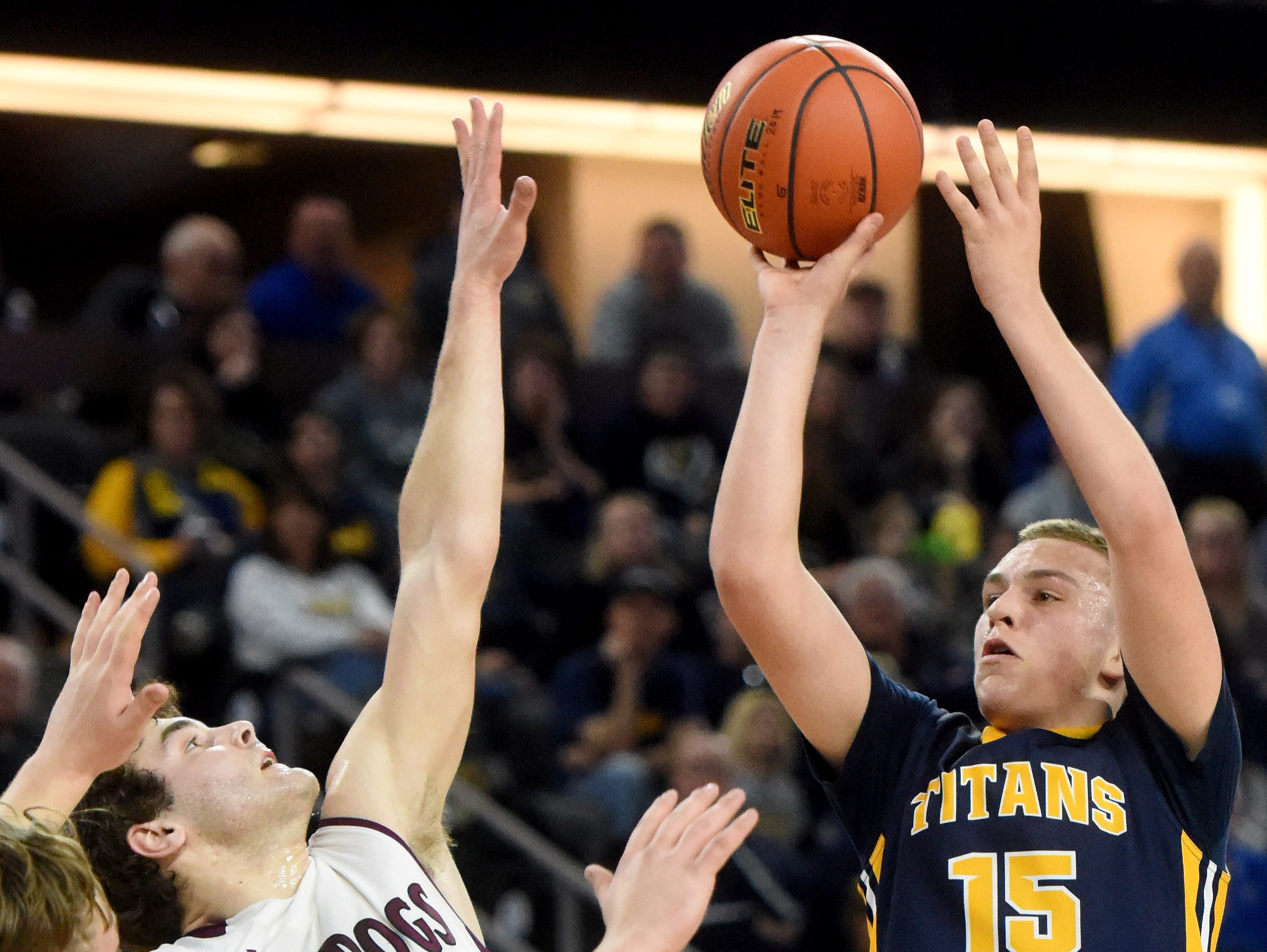 Tea Area's Noah Freidel shoots over Madison's Marcus VandenBosch during the 2017 SDHSAA Class A boy's basketball championship at the Denny Sanford Premier Center on Saturday, March 18, 2017.