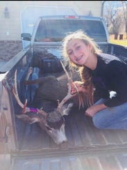 On top of the spike elk, Olivia Isakson also harvested